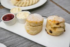 Two style scone with three dips. On white dish stock image