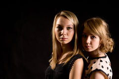 Two stylish blonde teenagers Stock Images