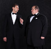 Two stylish businessman in tuxedos Stock Image