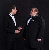 Two stylish businessman in tuxedos Royalty Free Stock Images