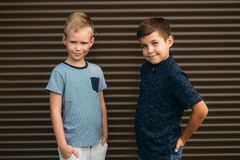 Two stylish childrend posing to the photograher.  royalty free stock photo