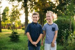 Two stylish childrend posing to the photograher.  stock photography
