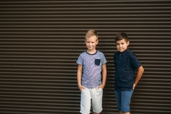 Two stylish childrend posing to the photograher.  stock images