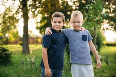 Two stylish childrend posing to the photograher.  stock photos