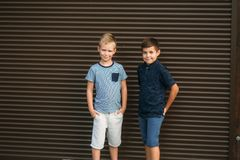 Two stylish childrend posing to the photograher. Youn model.  royalty free stock images
