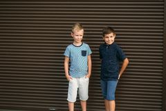 Two stylish childrend posing to the photograher. Youn model.  stock image