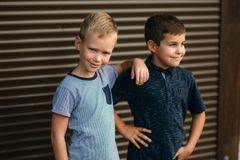 Two stylish childrend posing to the photograher. Young model.  stock photos