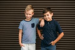 Two stylish childrend posing to the photograher. Young model.  royalty free stock image