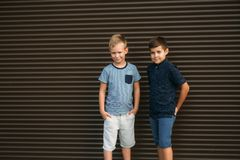Two stylish childrend posing to the photograher. Young model.  royalty free stock photo