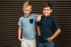 Two stylish childrend posing to the photograher. Young model.  stock photography