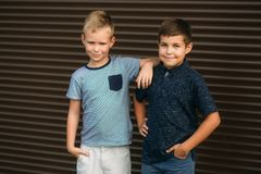 Two stylish childrend posing to the photograher. Young model.  stock photo