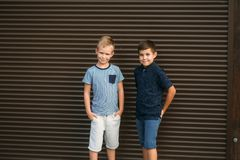 Two stylish childrend posing to the photograher. Young model.  royalty free stock photography