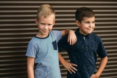 Two stylish childrend posing to the photograher. Young model.  royalty free stock images