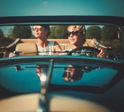 Two stylish ladies in a car. Two stylish ladies in a classic convertible Stock Photo