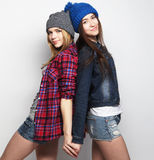 Two stylish sexy hipster girls best friends Stock Images