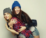 Two stylish sexy hipster girls best friends Royalty Free Stock Photos