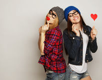 Two stylish sexy hipster girls best friends Royalty Free Stock Photography