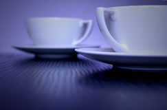 Two Stylish White  Cups on table Royalty Free Stock Photos