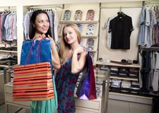 Two stylish women with paperbags meet in mall Stock Photo