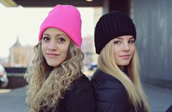 Two stylish young blonde girls Stock Photos