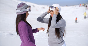 Two stylish young woman chatting at a ski resort Stock Images