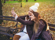 Two stylish young women taking a selfie Stock Photos