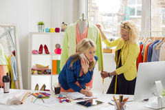 Two stylists at their office working Royalty Free Stock Photo