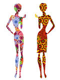 Two stylized slender ethnic women. Two slender stylized young models in ornate motley multicolour long ethnic clothes, vector stencils isolated on the white Stock Photos