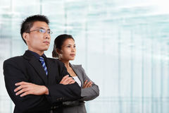 Two successful Asian business people Royalty Free Stock Photo