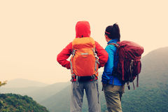 Two successful backpacker enjoy the beautiful landscape Stock Image