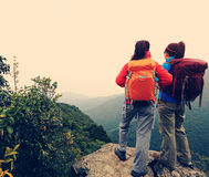 Two successful backpacker enjoy the beautiful landscape Stock Photography