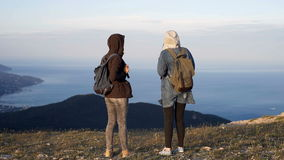 Two successful backpacker enjoy the beautiful landscape at mountain peak.  stock video footage