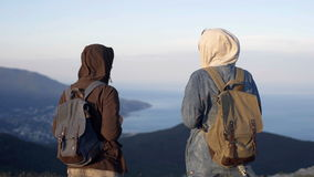 Two successful backpacker enjoy the beautiful landscape at mountain peak.  stock footage