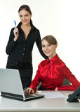 Two successful business ladies. Two young successful business ladies on white backgrond stock photos