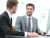 Two successful business men discussing documents in a modern off Royalty Free Stock Images