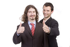 Two successful business men with thumb up stock photography