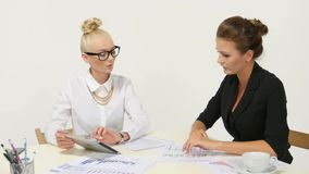 Two successful business partners working at. Image of two successful business partners working at meeting in office stock footage