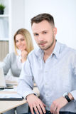 Two successful business partners working at meeting in office Royalty Free Stock Image