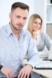 Two successful business partners working at meeting in office stock photography