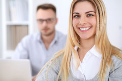Two successful business partners working at meeting in office stock image