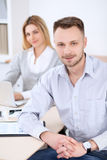Two successful business partners working at meeting in office. Focus on man royalty free stock images