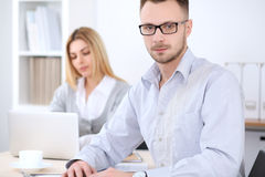 Two successful business partners working at meeting in office. Focus on man Stock Photo