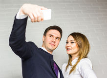 Two successful business people taking a happy Selfie in the office. Stock Images