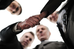 Two successful businessman shaking hands. At front of corporate team in office Stock Images