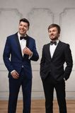 Two successful businessmen. Funny men dressed in suite with different emotions Royalty Free Stock Photo
