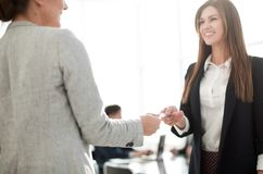 Two successful businesswomen exchange their business cards. Photo with text space stock photos
