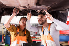 Two successful car mechanics Stock Images