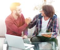 Two successful designers shake hands after doing a good job. Photo with copy space royalty free stock photo