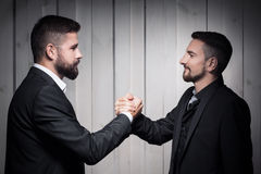 Two successful men shake hands Stock Images