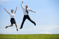 Two successful people jumping Royalty Free Stock Photo